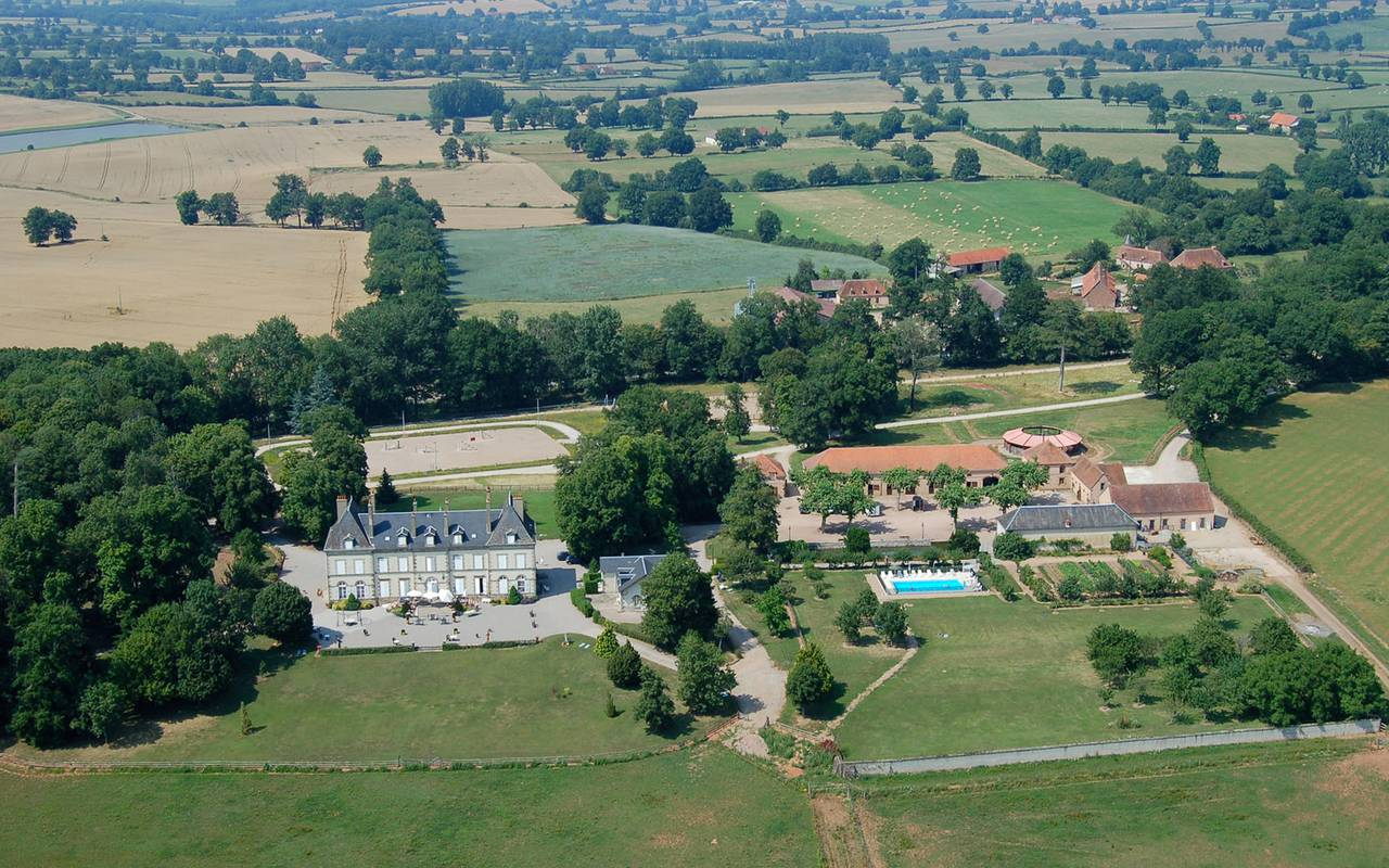 view from above of the hotel and its garden with swimming pool, luxury hotel auvergne, Château d'Ygrande.
