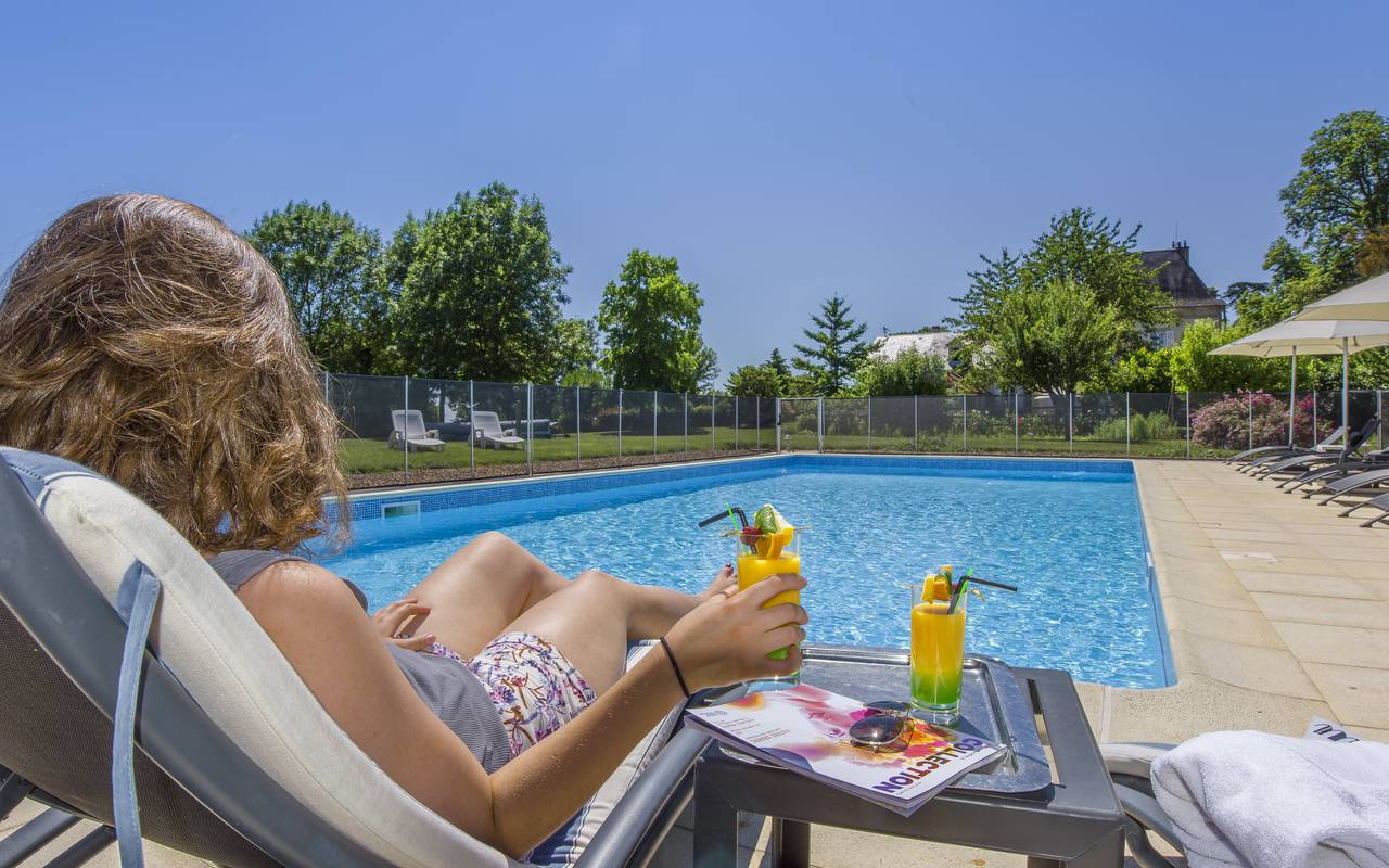 take time to drink one of our cocktails in the sun by the pool, luxury hotel auvergne, Château d'Ygrande.